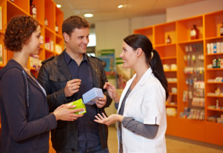 Pharmacist talking to couple