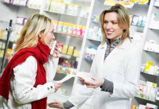 lady asking assistance to a pharmacist
