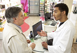 old man asking assistance to a pharmacist